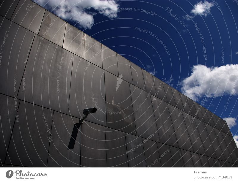 Sky Blue Clouds Wall (building) Wall (barrier) Gray Weather Sign Might Media Camera Surveillance Measure Live Investigate Informer