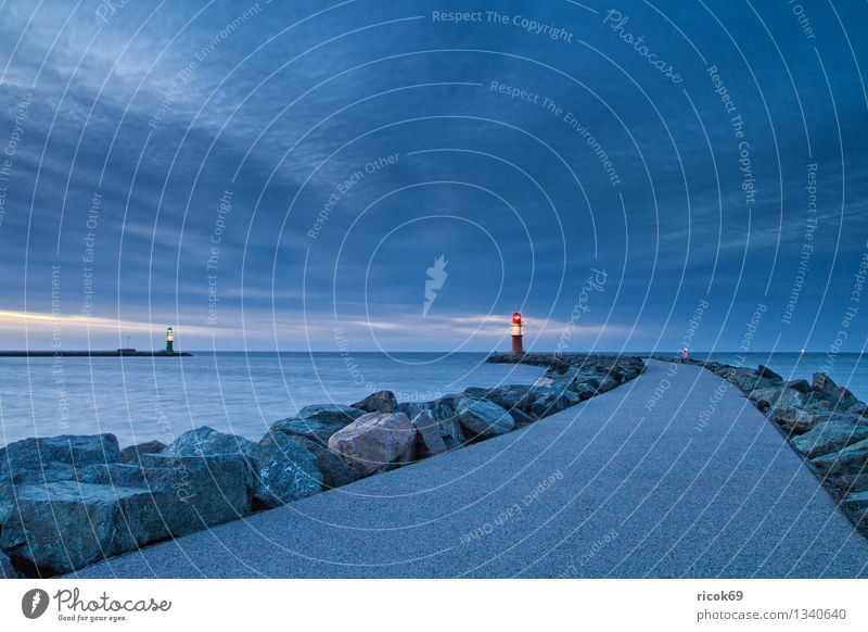 Mole in the evening Vacation & Travel Water Clouds Coast Baltic Sea Ocean Tower Lighthouse Architecture Tourist Attraction Landmark Lanes & trails Stone Blue