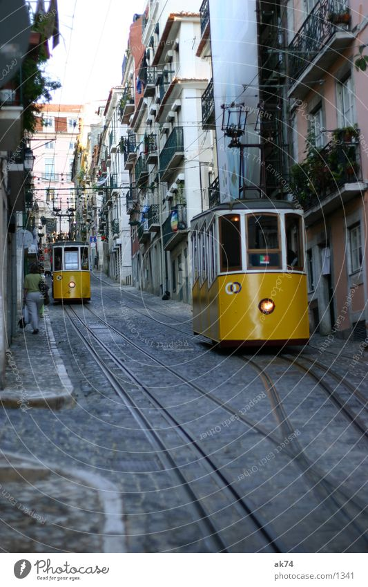 uphill Lisbon Tram Yellow Railroad tracks Transport Street