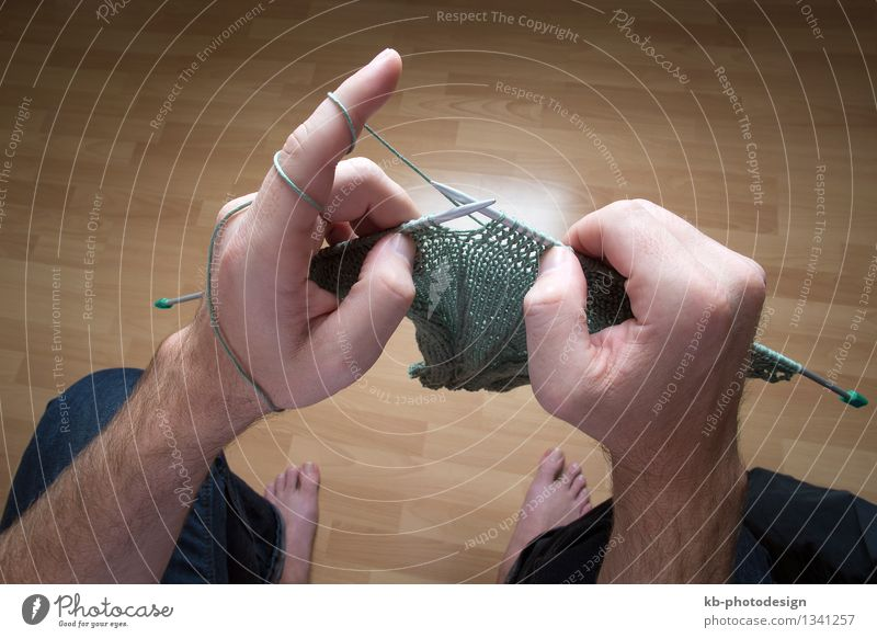 Closeup of a man knitting a green scarf at home Leisure and hobbies Winter Man Adults Hand 1 Human being Warmth Make wool Ball thread do it yourself DIY