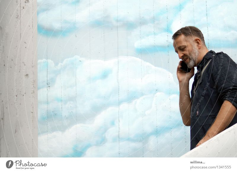 Human being Man Clouds Graffiti To talk Business Facade Masculine Success 45 - 60 years Communicate Future Telecommunications Contact Facial hair Cellphone