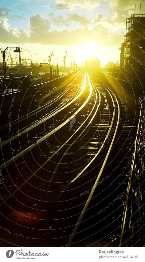 Always further Railroad tracks Back-light Sunset Underground Commuter trains Lighting Glittering Radiation Forwards Right ahead Train station Hamburg