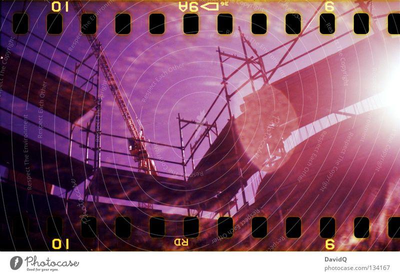 under construction Construction site Framework Crane Sunbeam Patch of light Multicoloured Film Craft (trade) Lomography Scaffold Lens flare Colour color 35mm