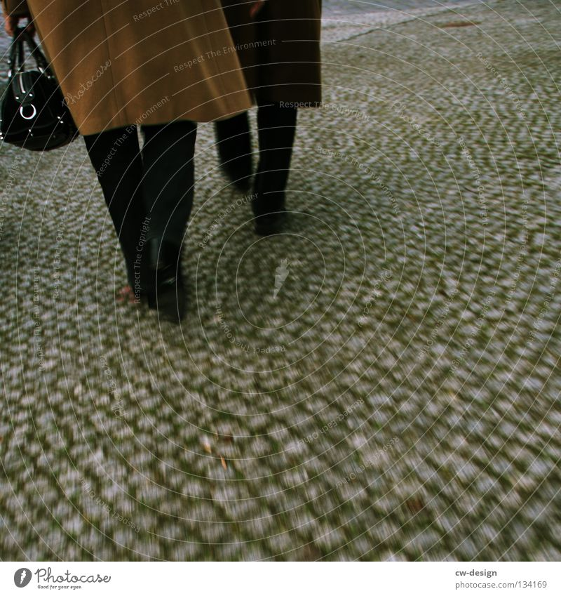 DOLCE & GABBANA Woman Man Footwear Ground level Coat Pants Gray scale value Winter Autumn Gloomy Blur Floor covering Pattern Married couple Cobblestones