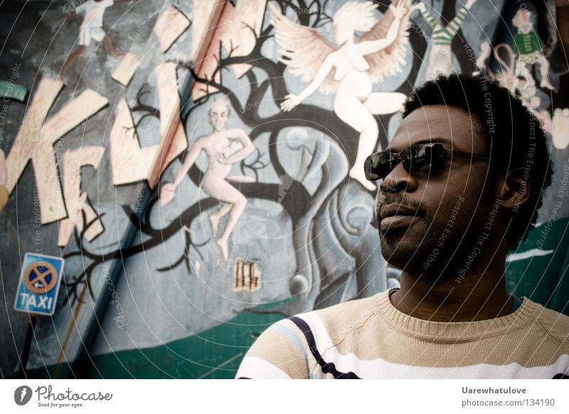 Think with your fantasy Dream Intoxicant Creativity Africa Hip-hop Wall (building) Sunglasses Art Culture Street sign Fantasy literature ponder Wait