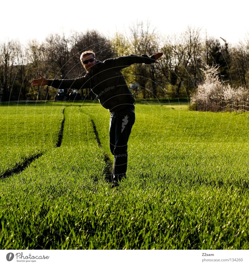 unbalanced Contentment Green Meadow Stripe Field Black Man Masculine Stand Blonde Summer Physics Tree Human being Line Farmer Arm Warmth Nature Landscape