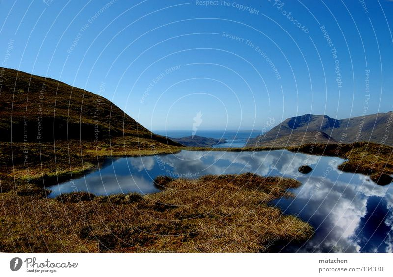 Water Beautiful Sky Ocean Blue Calm Clouds Far-off places Relaxation Grass Mountain Freedom Lake Landscape Air Power
