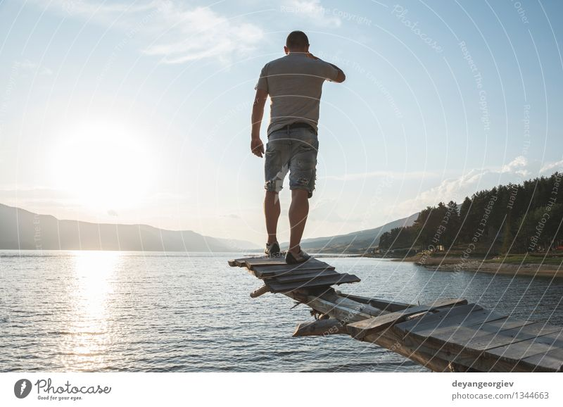 Boy in front of mountain dam Lifestyle Happy Beautiful Relaxation Leisure and hobbies Vacation & Travel Tourism Adventure Camping Summer Mountain Hiking Sports