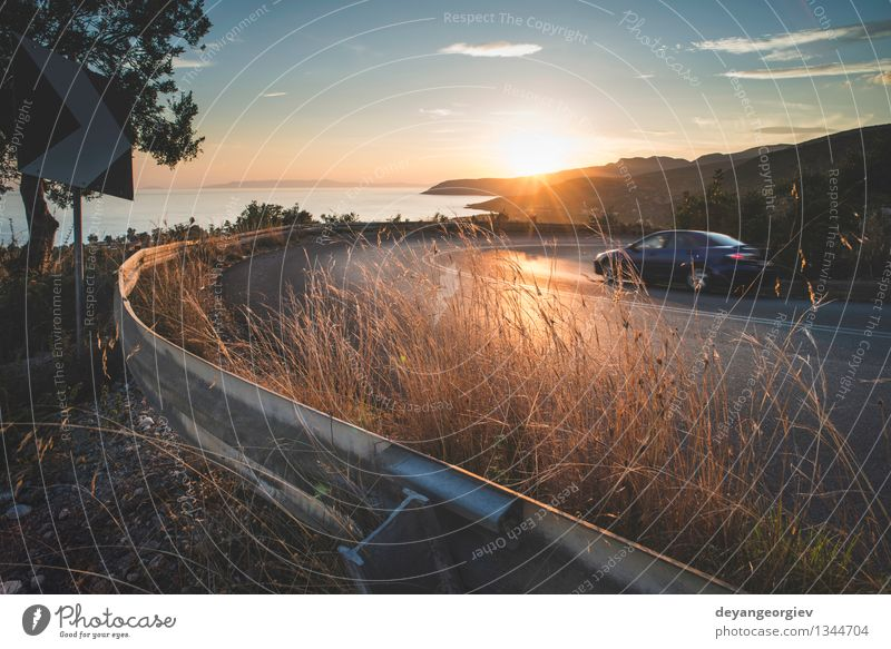 Mediterranean road on sunset. Vacation & Travel Sun Mountain Environment Nature Landscape Earth Sky Autumn Tree Grass Forest Rock Canyon Village Transport