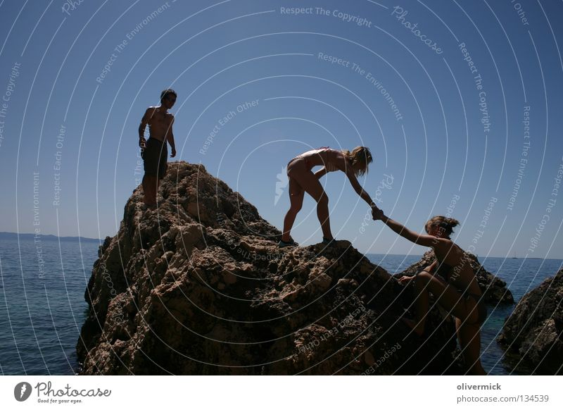 "helpful Ocean Friendship Help Trust Water Clarity stone coast Stone Rock ""Cliff"" Observe Sky Blue"