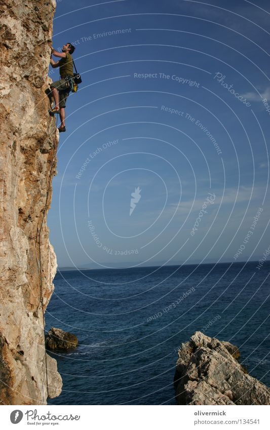 over the sea Ocean Clouds Cliff Brave Mountaineer Trust Endurance Joy Blue sky Stone Rock Climbing Power