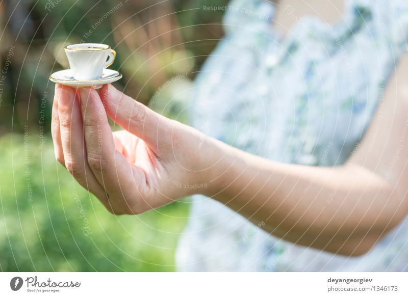 Hand Hold Very Small Cup Of Coffee A Royalty Free Stock
