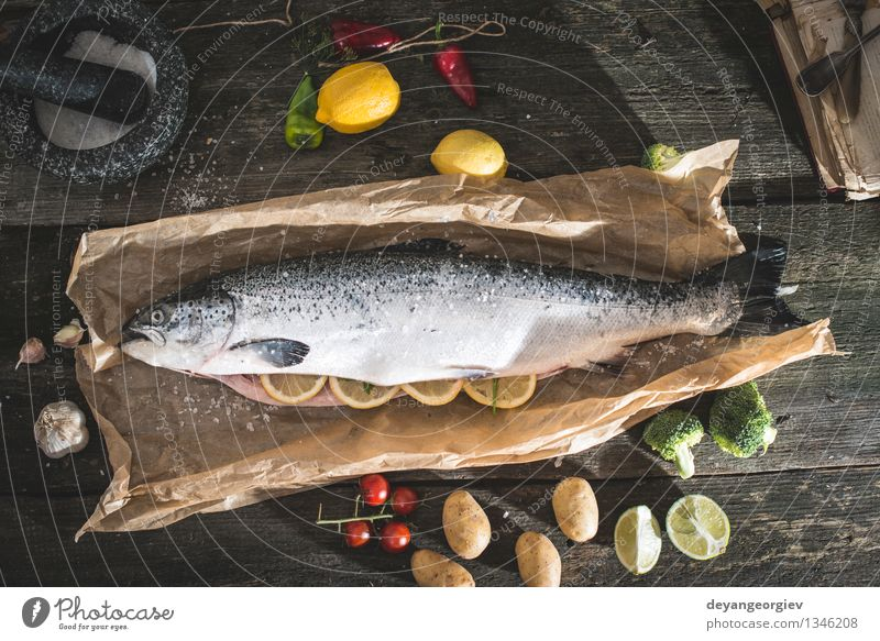 Preparing whole salmon fish for cooking Seafood Vegetable Dinner Table Rope Paper Dark Fresh Delicious Black Cooking Raw Ingredients Meal Lemon Preparation