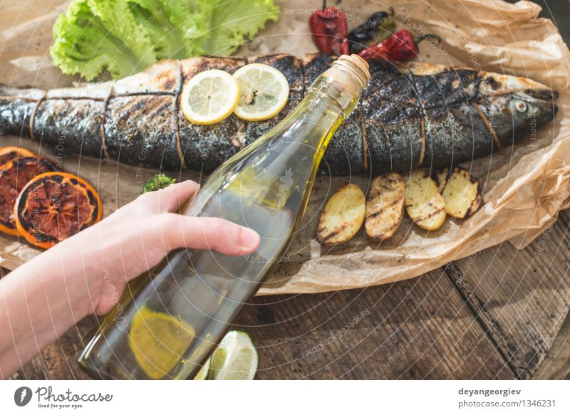 Roasted salmon and vegetables White Hand Natural Fresh Cooking & Baking Paper Vegetable Delicious Bottle Meal Dinner Diet Salad Lemon Raw Potatoes