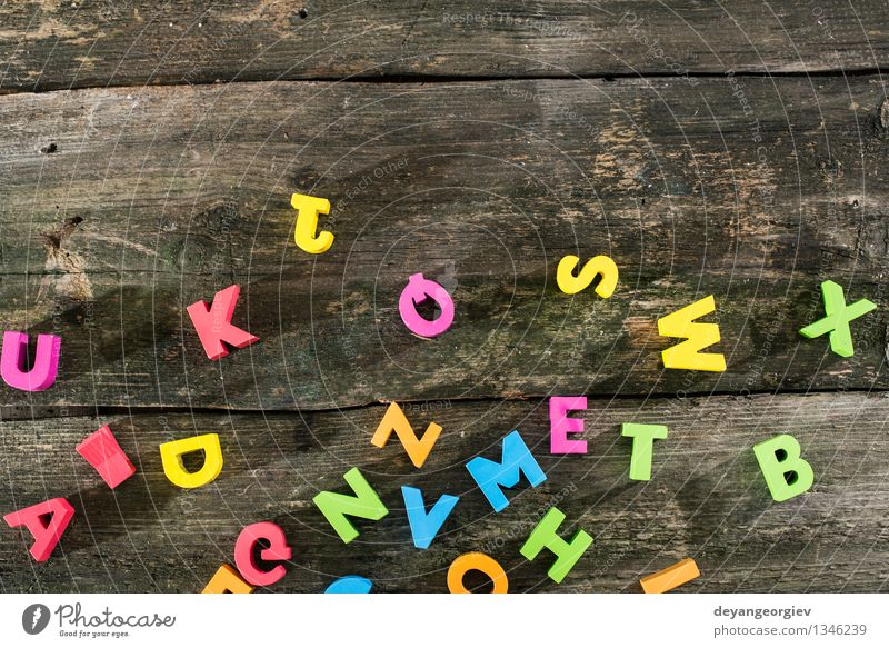 Wooden letters on wooden board Design Paper Toys Collection Old Colour alphabet colorful vintage Text background Cast iron Word abc Preschool Typography type