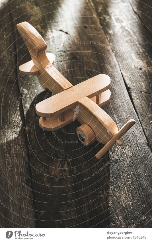 Vintage wooden plane on wooden board Vacation & Travel Craft (trade) Air Transport Airplane Aircraft Toys Old Small Retro Tradition vintage Model handmade fly