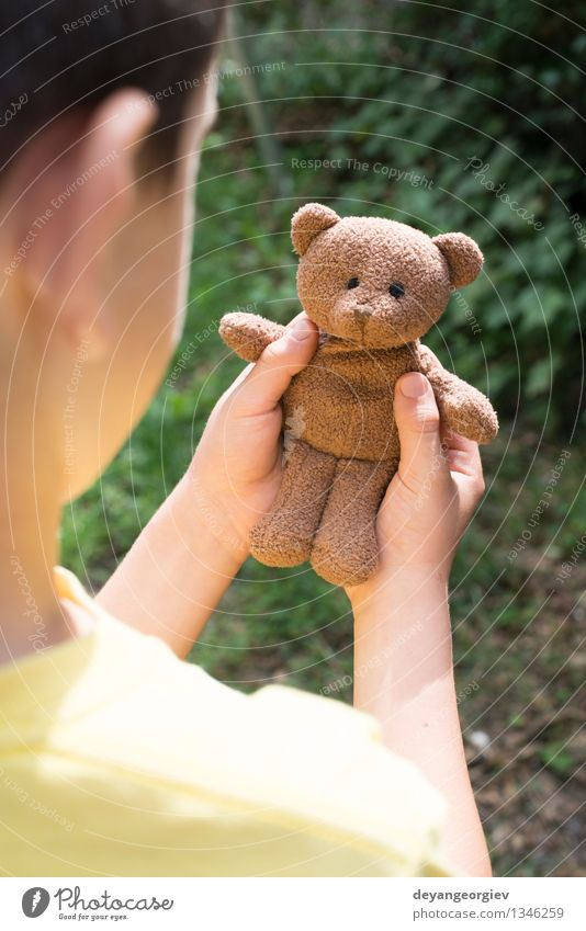 Child hold teddy Playing Baby Girl Boy (child) Infancy Hand Toys Teddy bear Small Brown Bear kid Hold sad young one Portrait photograph