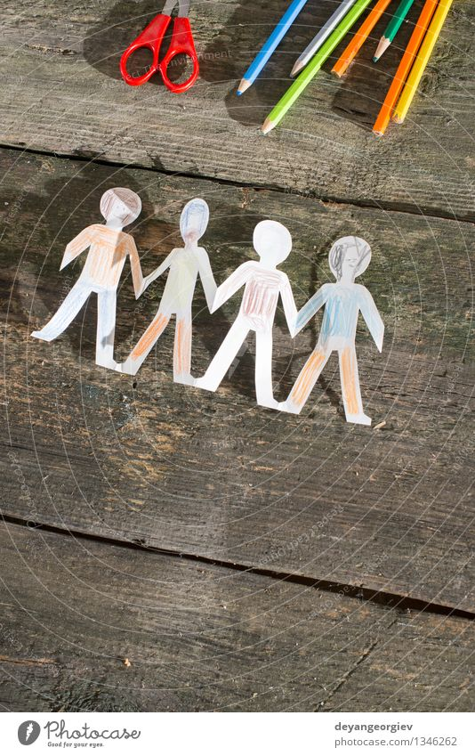 Paper made people figures Design Child Family & Relations Friendship Hand Group Together White Teamwork wooden Pencil team Figure chain cutout Hold