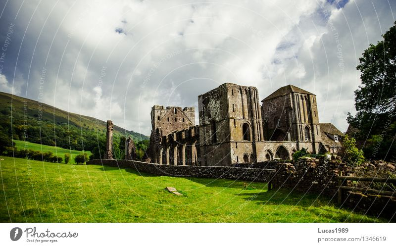 monasteries Landscape Clouds Bad weather Gale Tree Grass Bushes Moss Garden Park Meadow Church Castle Monastery Monastery garden Ruin Old Historic Blue Gray