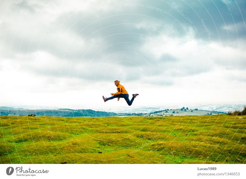Adventurer or hiker jumps high on green meadow Lifestyle Leisure and hobbies Vacation & Travel Tourism Trip Far-off places Freedom Expedition Mountain Hiking