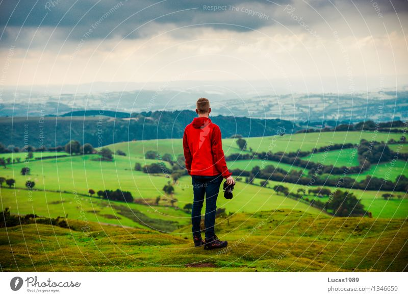 young man in front of hilly landscape Vacation & Travel Tourism Adventure Far-off places Freedom Expedition Mountain Hiking Photographer Human being Masculine