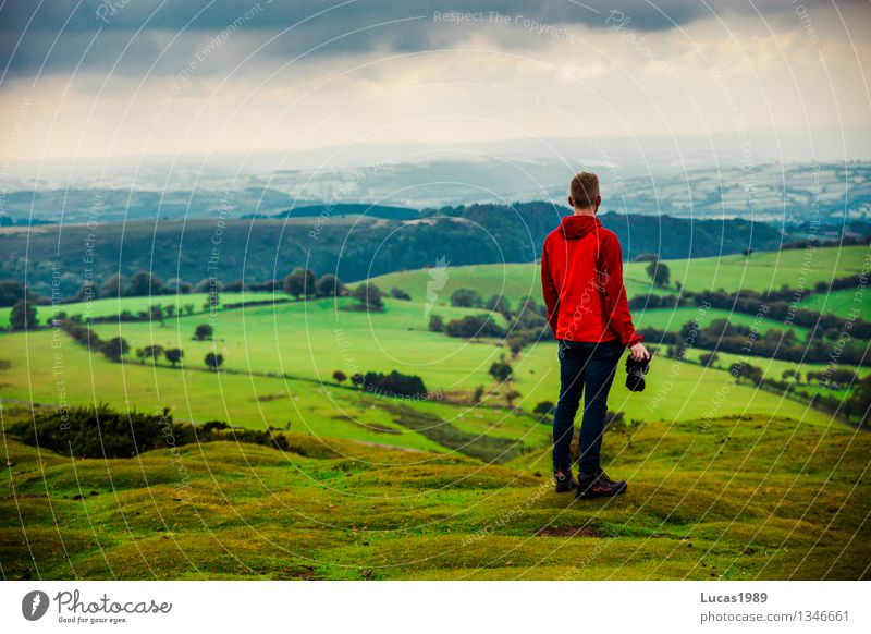 young man in front of hilly landscape Vacation & Travel Tourism Adventure Far-off places Freedom Hiking Human being Masculine Young man Youth (Young adults) Man