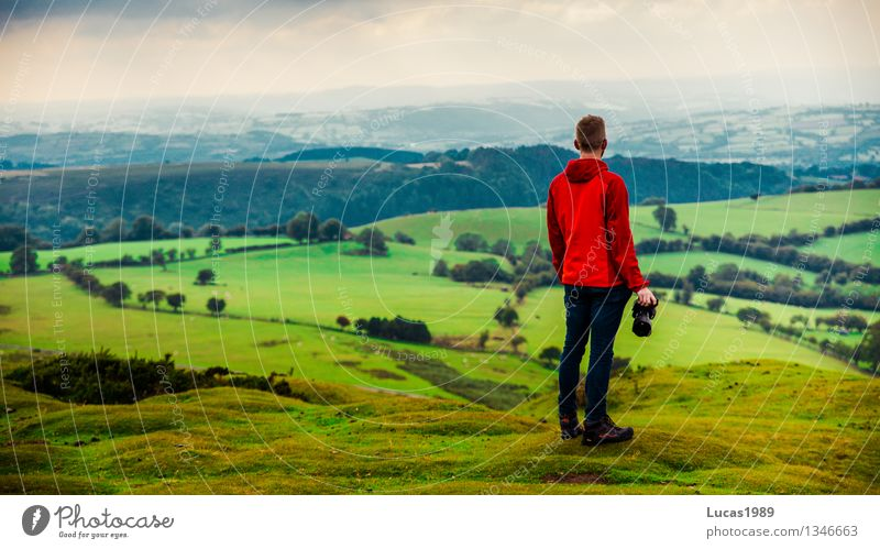 young man in front of hilly landscape Vacation & Travel Trip Adventure Far-off places Mountain Hiking Photographer Human being Masculine Young man