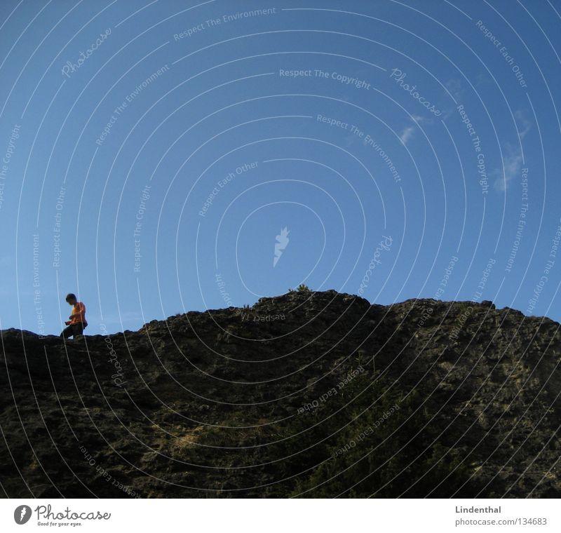 Jump the Hill Fellow Sweater Mountain Child Boy (child) Climbing Rock Tall Sky Blue Orange
