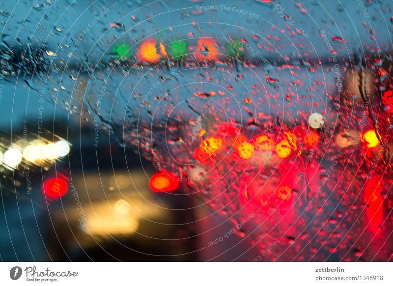 Motorway again Highway Rush hour Traffic jam Rain Rainwater Autumn Weather Windscreen Window Car Window Drops of water Light Floodlight Car headlights