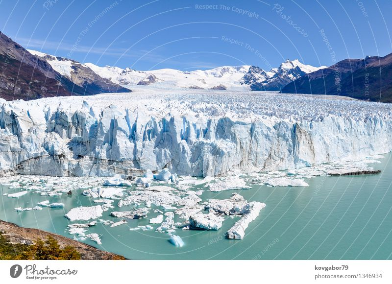 Frontal view of Perito Moreno Glacier, Argentina Sky Nature Vacation & Travel White Landscape Clouds Park Tourism Vantage point Beauty Photography South