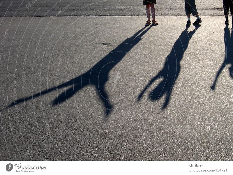 seemingly giant Shadow Child Joy Applause Black Gray Silhouette Arm Sunset Asphalt Concrete Pavement Tar High spirits Hop Vacation & Travel Free Freedom 3
