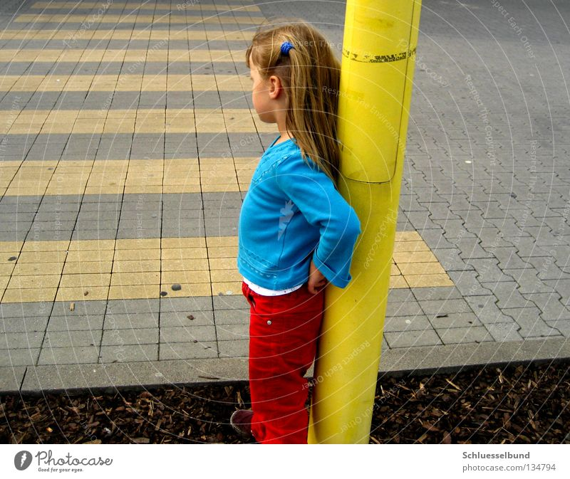Child Girl Red Yellow Street Hair and hairstyles Stone Brown Stand Pants Traffic infrastructure Sweater Long-haired Braids Lean Roadside
