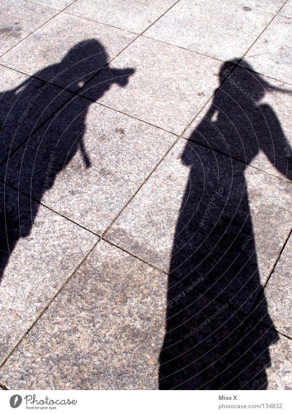 Fucking paparazzi. Colour photo Black & white photo Exterior shot Shadow Silhouette Human being Woman Adults Man Legs Street Gray Asphalt Stony In transit