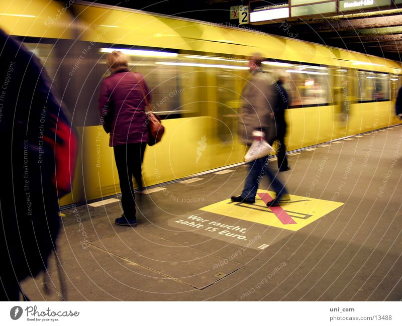 Berlin's fast subway Platform Railroad tracks Human being No smoking Transport yellow subway move Passenger