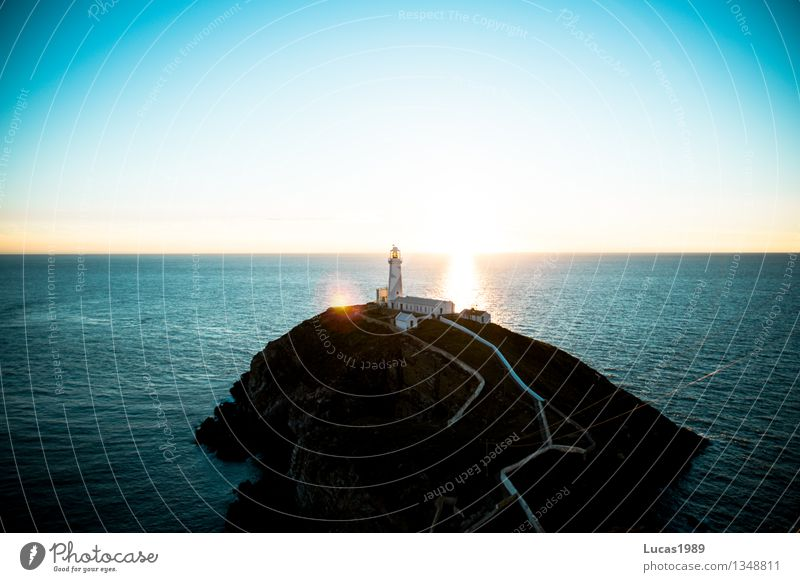 An island with a lighthouse Vacation & Travel Tourism Trip Adventure Far-off places Freedom Sightseeing Environment Nature Landscape Water Cloudless sky Sunrise