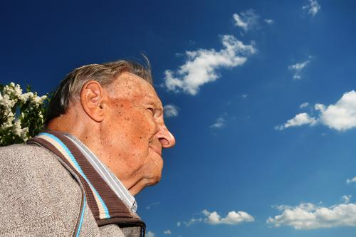 Grandpa's on the lookout. Man Senior citizen Grandfather Future Hope Vantage point Skeptical Contentment Retirement Sky Looking Male senior Laughter Happy
