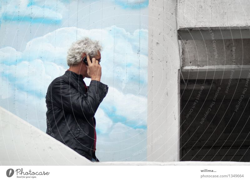 Human being Man Clouds Graffiti To talk Business Facade Success 45 - 60 years Communicate Future Telecommunications Contact Cellphone Connection Downward