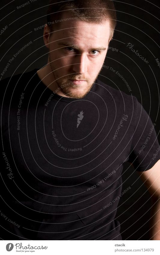 young man portrait Human being Portrait photograph Posture Man Masculine Partially visible Section of image Looking into the camera T-shirt Dark background