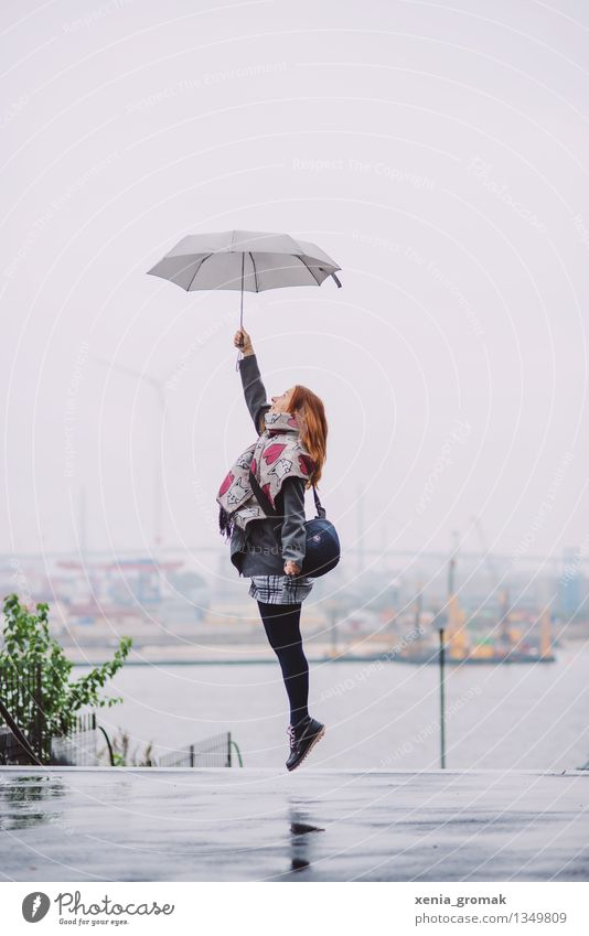 Human being Sky Vacation & Travel Youth (Young adults) Young woman Joy Life Autumn Playing Gray Lifestyle Freedom Flying Jump Rain Contentment