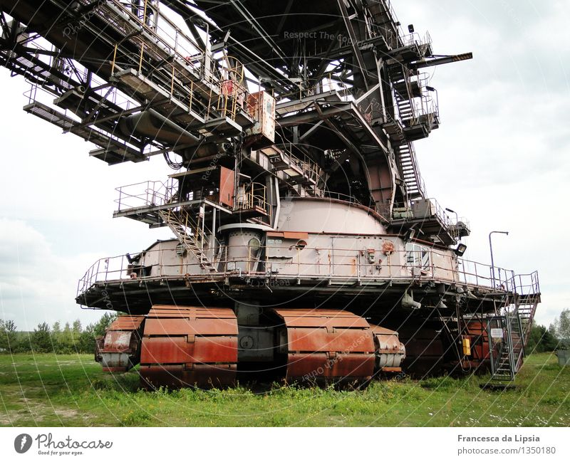 ferropolis Machinery Time machine Soft coal dredger Technology Industry Outdoor festival Deserted Industrial plant Metal Steel Rust Old Gigantic Historic Brown