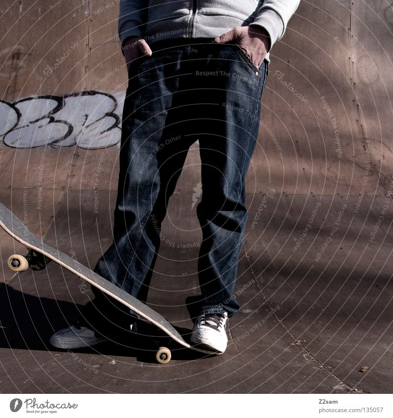 Human being Man Youth (Young adults) Sports Relaxation Style Wood Graffiti Lighting Arm Masculine Concrete Sit Modern Cool (slang) Jeans