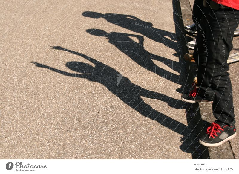 Shadowmen II Joy Leisure and hobbies Playing Child Family & Relations Infancy Youth (Young adults) Life Legs 3 Human being Group of children Street Asphalt Jump