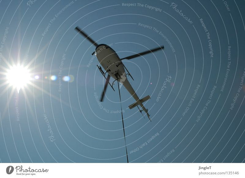 icarus Hover Helicopter Aircraft Snapshot Leashed Aviation Sky Sun Blue Beautiful weather Logistics