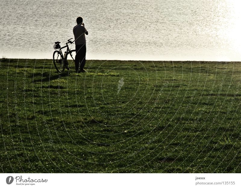 ponder Loneliness Bicycle Cycling tour Think Man Break Calm Lake Sunset Meadow Peace decision making Peaceful crisis meditative Human being Nature Lawn Looking