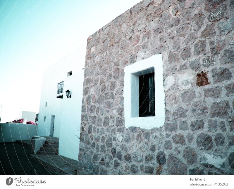 Beauty without frills Europe Spain Balearic Islands Ibiza Village Vacation home Moorish White Stone wall Window Fortress Light Historic Santa Eularia