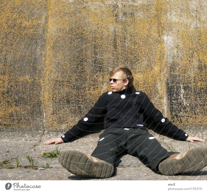 Human being Man Nature Youth (Young adults) Old Calm Loneliness Relaxation Wall (building) Wall (barrier) Masculine Signs and labeling Concrete Sit Arrangement
