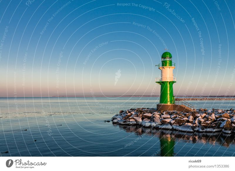 Warnemünde Ocean Winter Nature Landscape Water Cloudless sky Coast Baltic Sea Tower Lighthouse Architecture Tourist Attraction Landmark Stone Cold Blue Green
