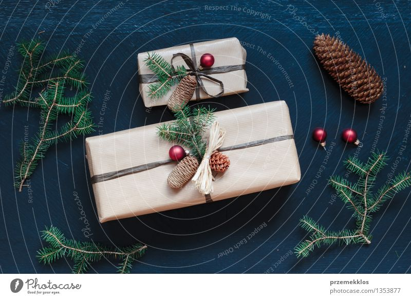 Wrapped Christmas presents on the table Paper Packaging Box String Culture Tradition Guest December Gift Home Horizontal Pine Colour photo Interior shot