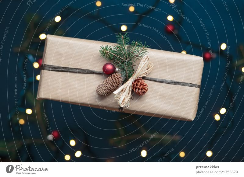 Wrapped Christmas present on the table Decoration Tradition December Gift Home Horizontal Pine Colour photo Interior shot Close-up Deserted Bird's-eye view Blur