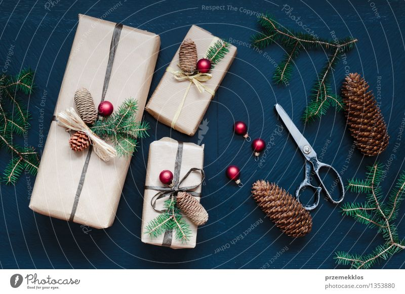 Wrapped Christmas presents on the table Handicraft Scissors Paper Packaging Box String Tradition Guest December Gift Home Horizontal Pine Seasons Colour photo